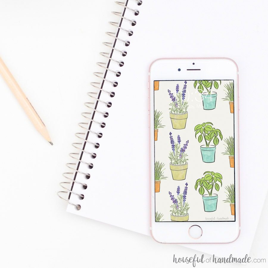 White iPhone with potted herbs pattern on the background. Free digital backgrounds for May from Housefulofhandmade.com.
