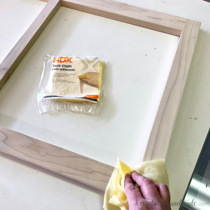 Tack cloths are great for removing dust. See all the tricks for how to paint unfinished cabinets from Housefulofhandmade.com.