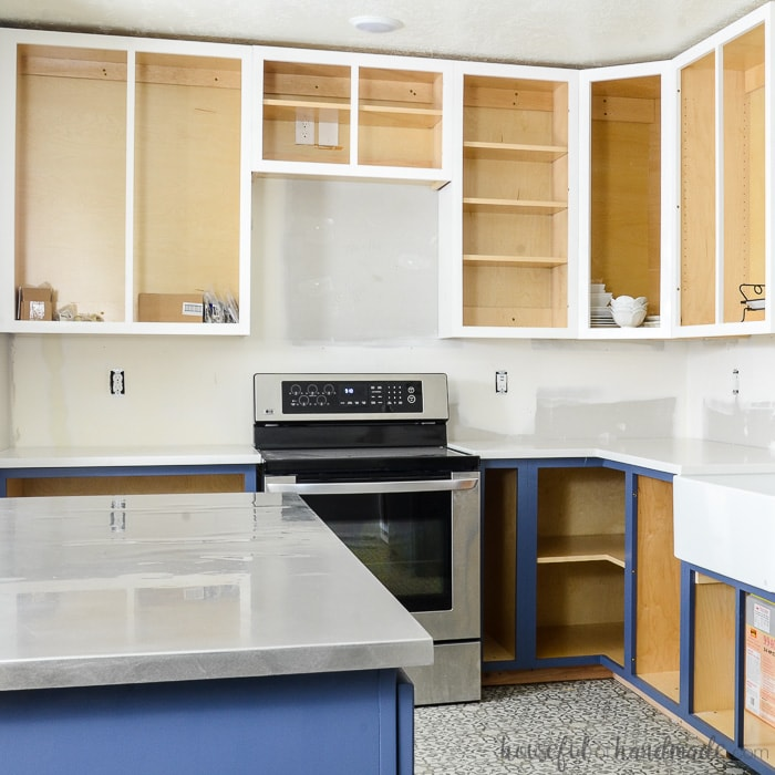 Kitchen with DIY cabinets installed without cabinet doors.