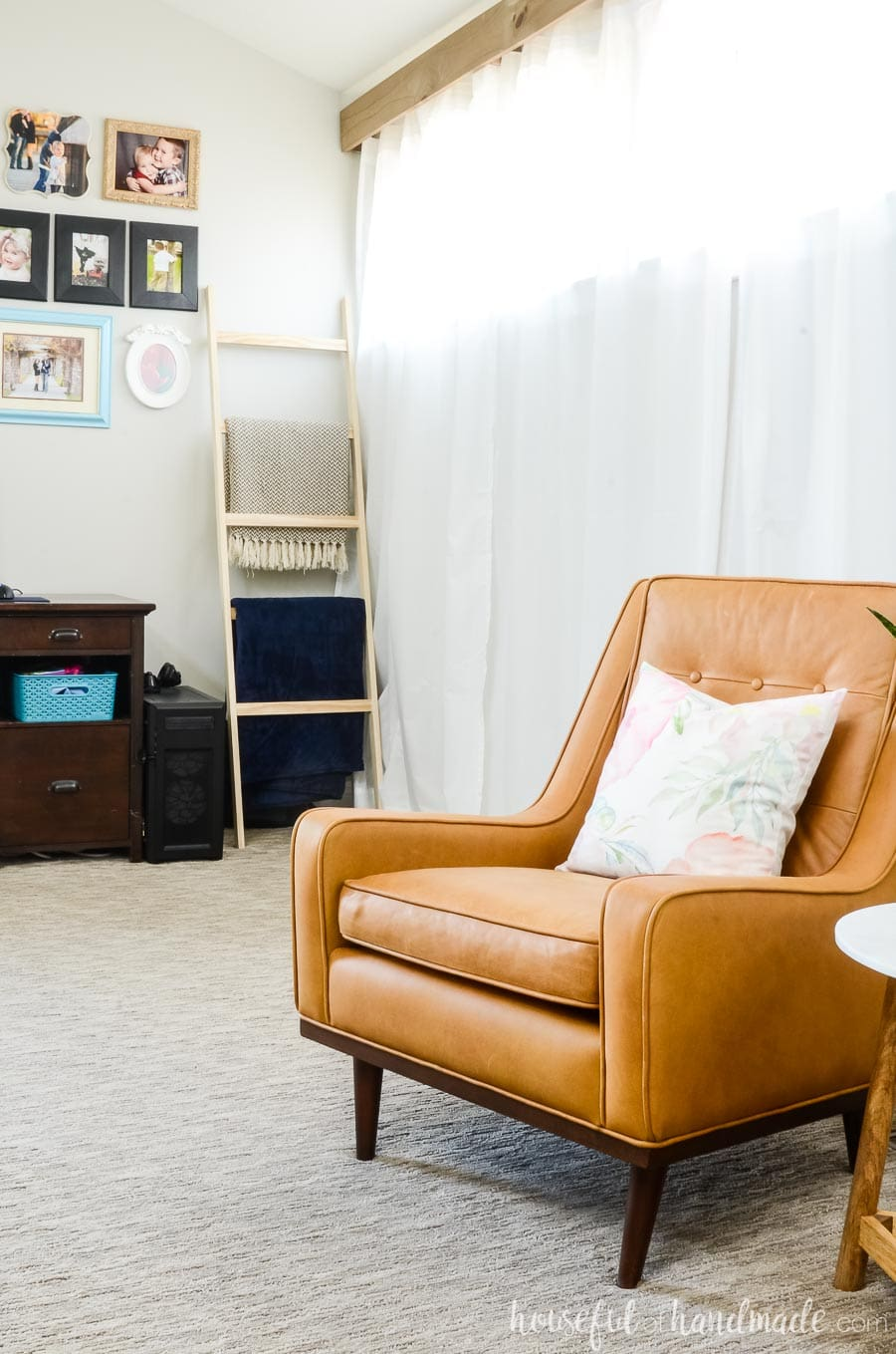 Tan armchair from Article.com in the living room with gallery wall and blanket ladder in the background. See how to easy it is to do a living room refresh for spring. Housefulofhandmade.com
