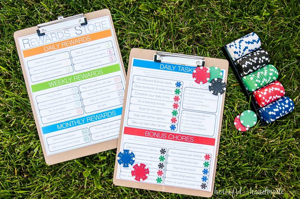 Printable kids chore chart shown on clipboard with coins on grass