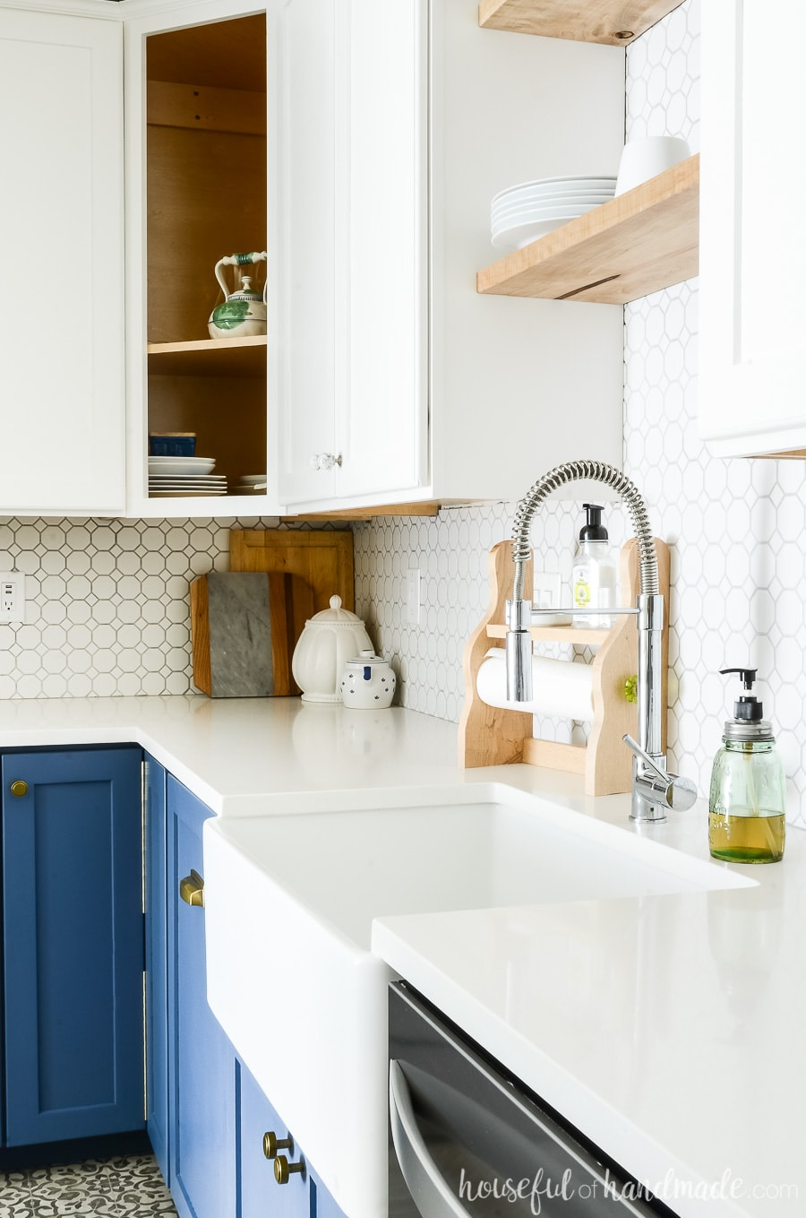 Kitchen remodel with white quartz countertops. Two tone kitchen cabinets with blue base cabinets and white upper cabinets.
