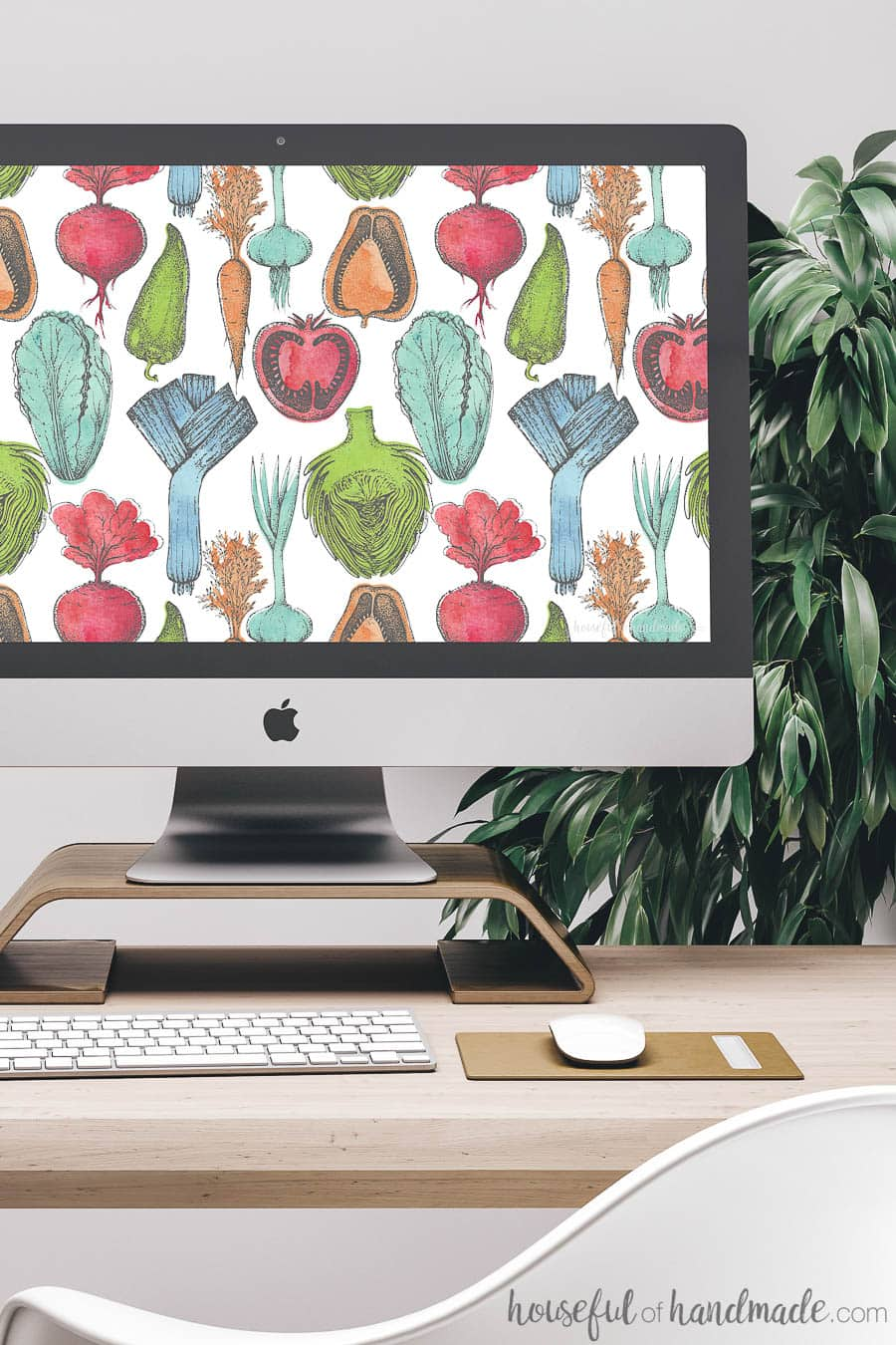 Desktop computer screen decorated with free digital wallpaper. The colorful watercolor produce design is reminiscent of summer farmers markets.