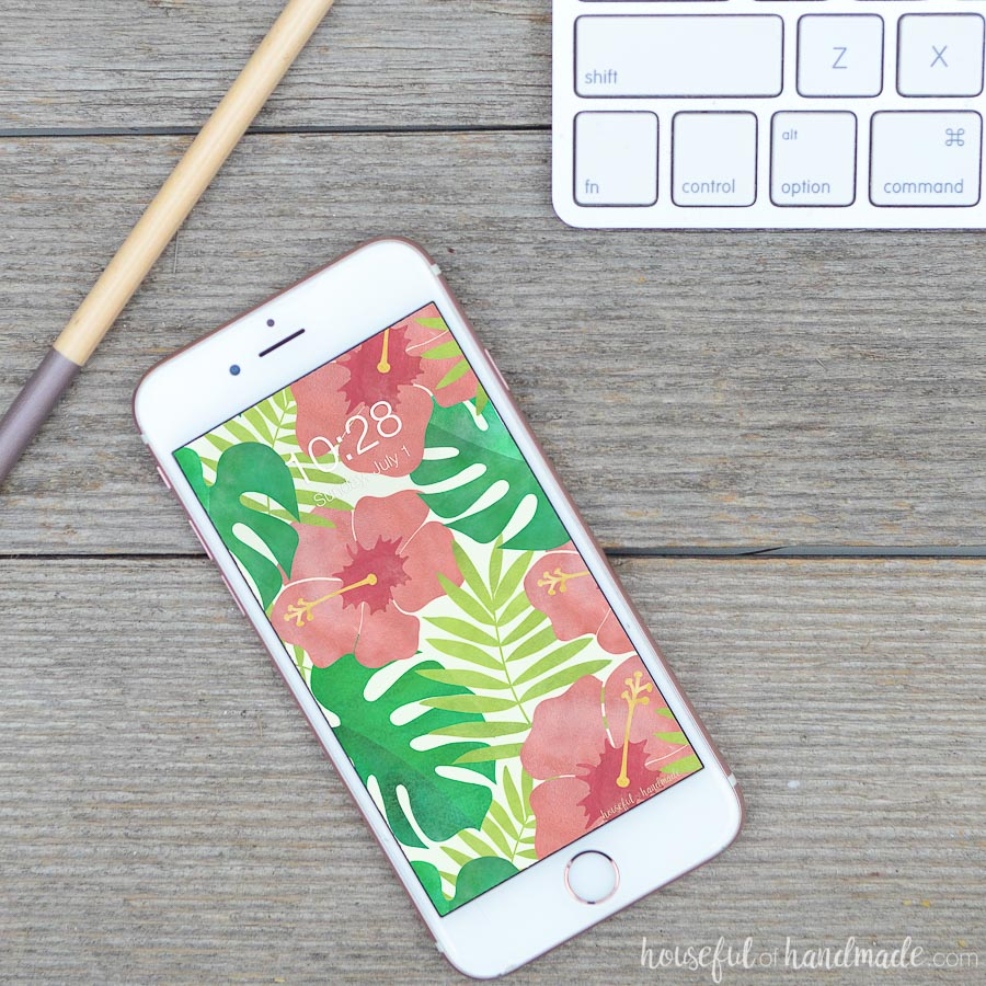 Tropical print digital wallpaper for your iPhone or computer. Bright hibiscus flowers and palm leaves free digital backgrounds from Housefulofhandmade.com.