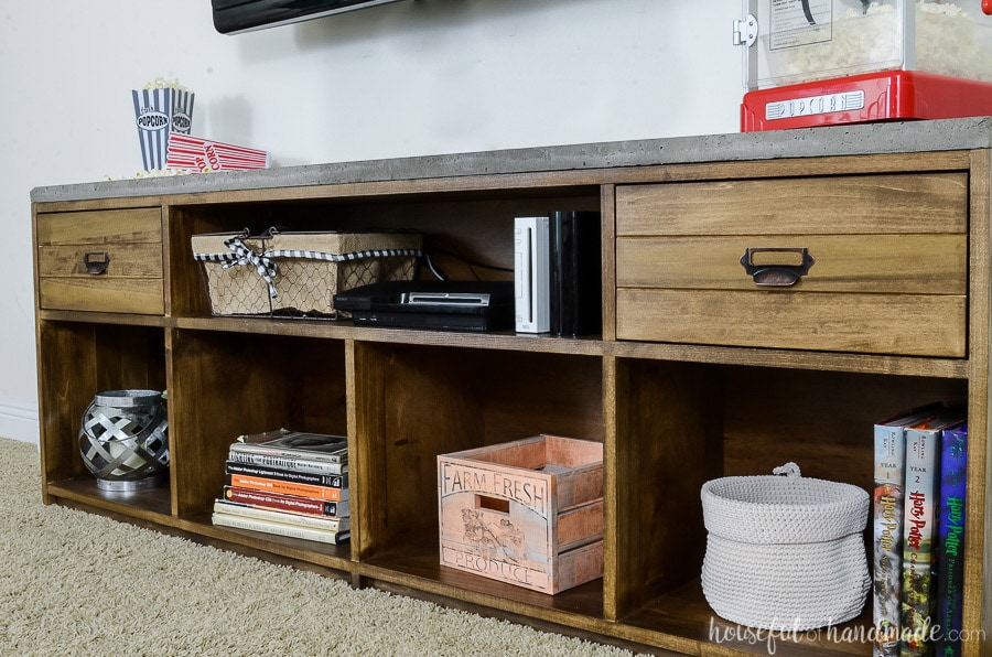 Large 6 foot long TV stand with open shelves and drawers. Rustic TV stand is topped with an industrial concrete top.
