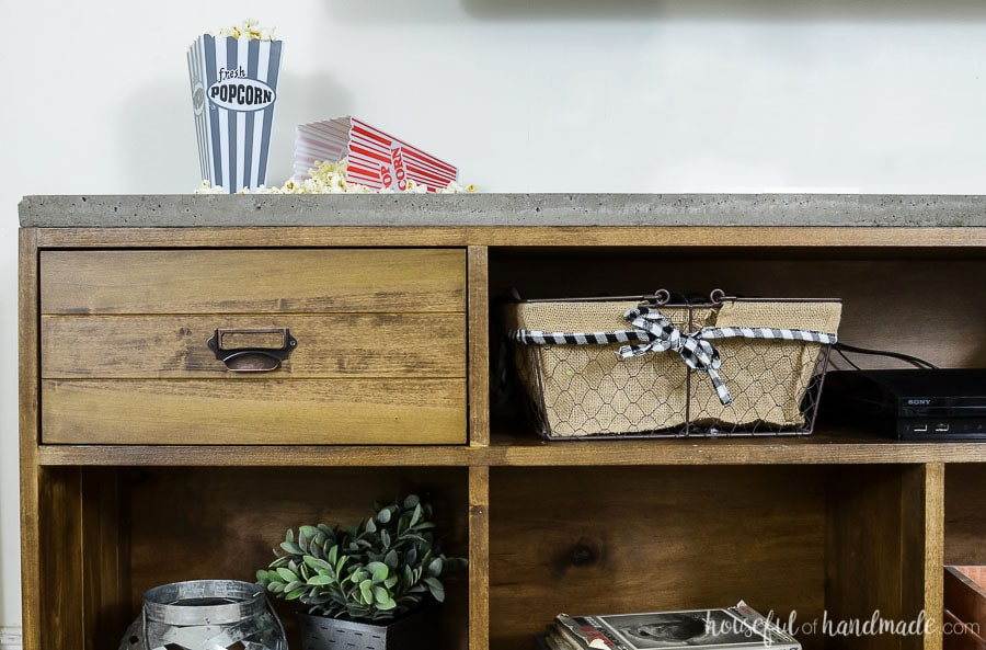 Cropped view of the rustic TV stand showing a close up of one of the 2 drawers. Routered detail on the drawer front.