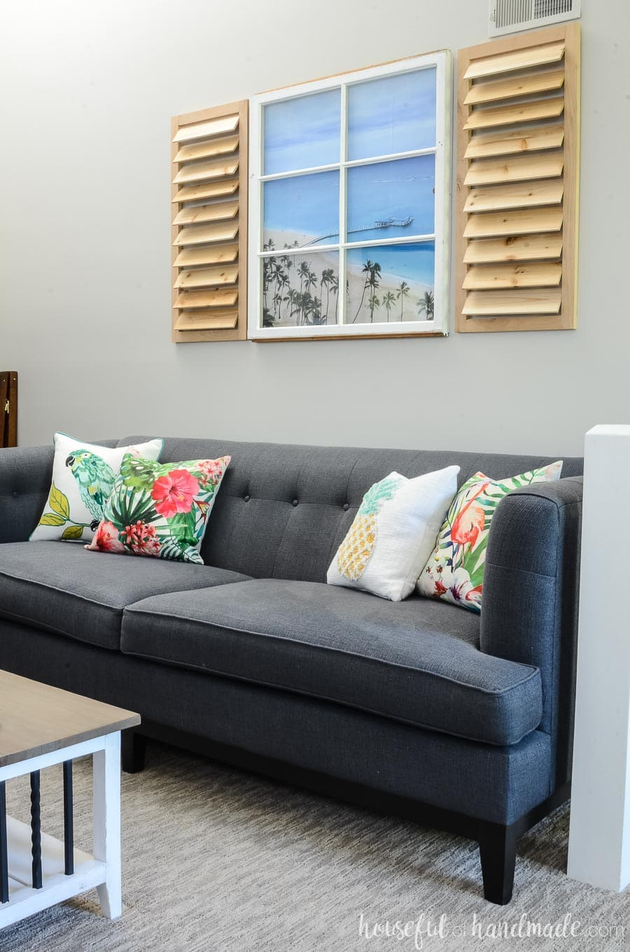 I love this idea for creating a tropical living room. Print a photo from a vacation and place behind an old window. Hang with decorative shutters. Housefulofhandmade.com
