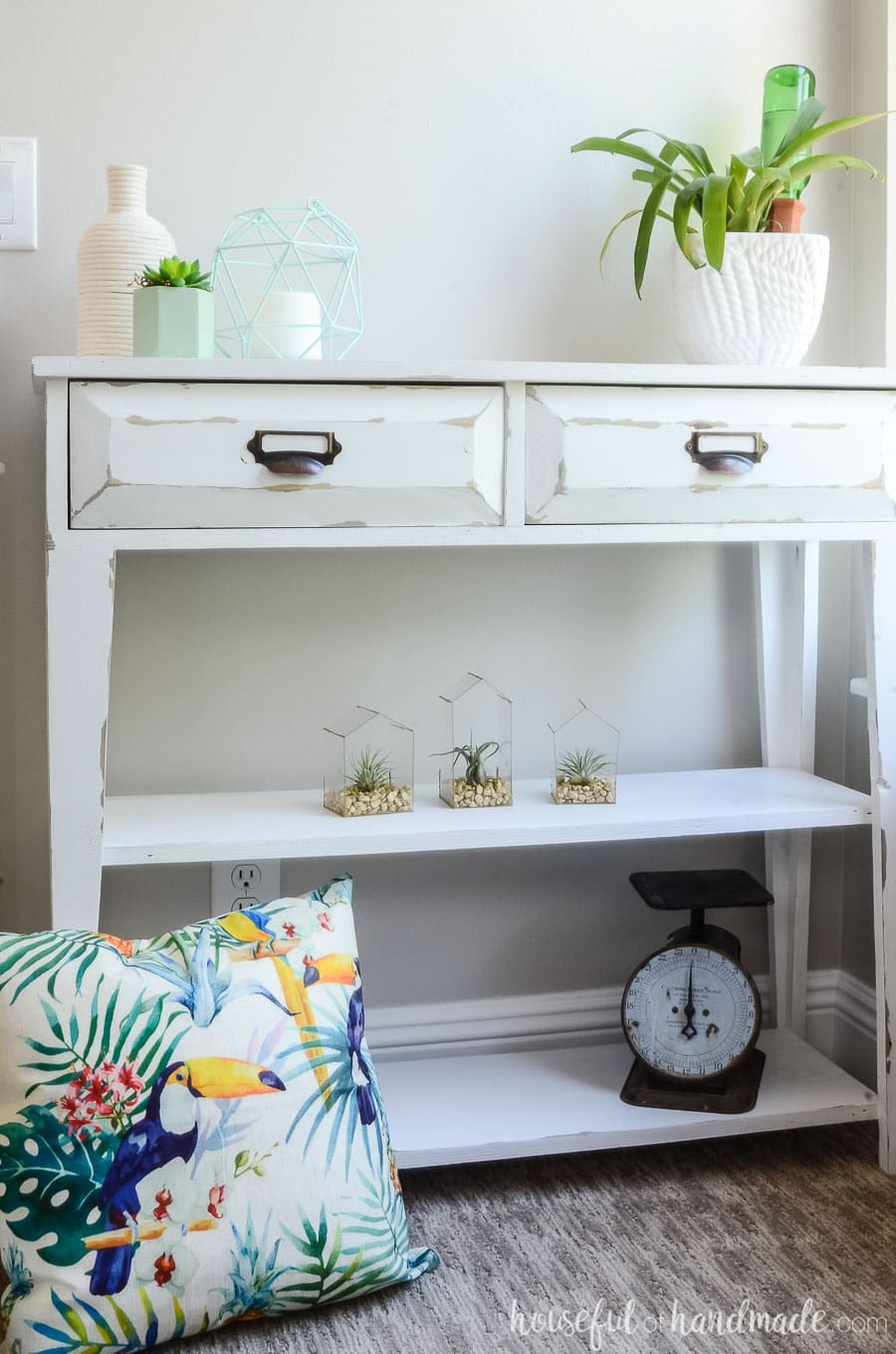 Shopping your home for accessories is an easy way to redecorate a room on a budget. See how we did that to make a tropical living room for summer. Housefulofhandmade.com