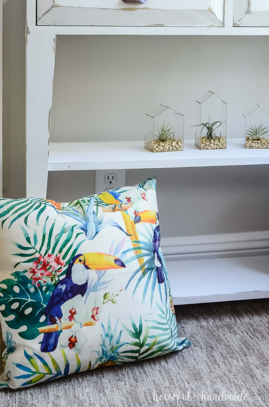 A tropical toucan pillow in front of our farmhouse console decorated for summer turns this room into a tropical living room. See the summer home tour at Housefulofhandmade.com.