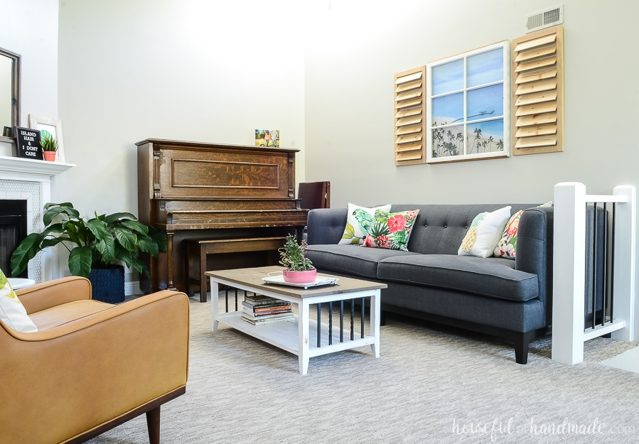 This tropical living room was decorated for summer on a budget. Get all the tips for how to create a tropical oasis in your home at Housefulofhandmade.com.