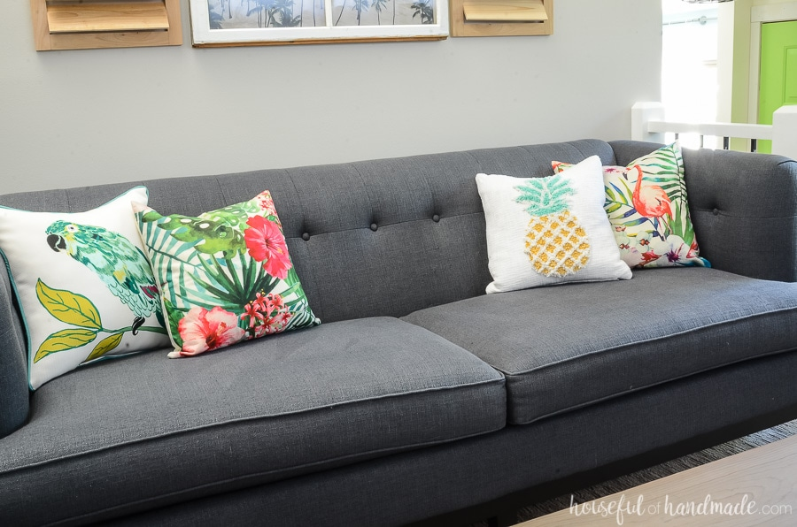 Pillows are an easy way to change out the decor in any room. We love these tropical pillows for our tropical living room. Get the complete summer living room tour at Housefulofhandmade.com.