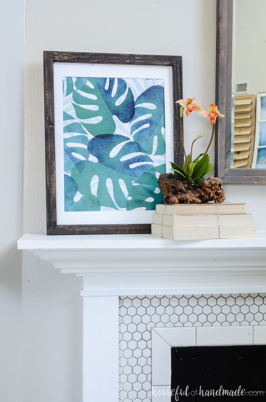 Tropical prints and vacation souvenirs are the perfect way to create a tropical living room for summer. Housefulofhandmade.com