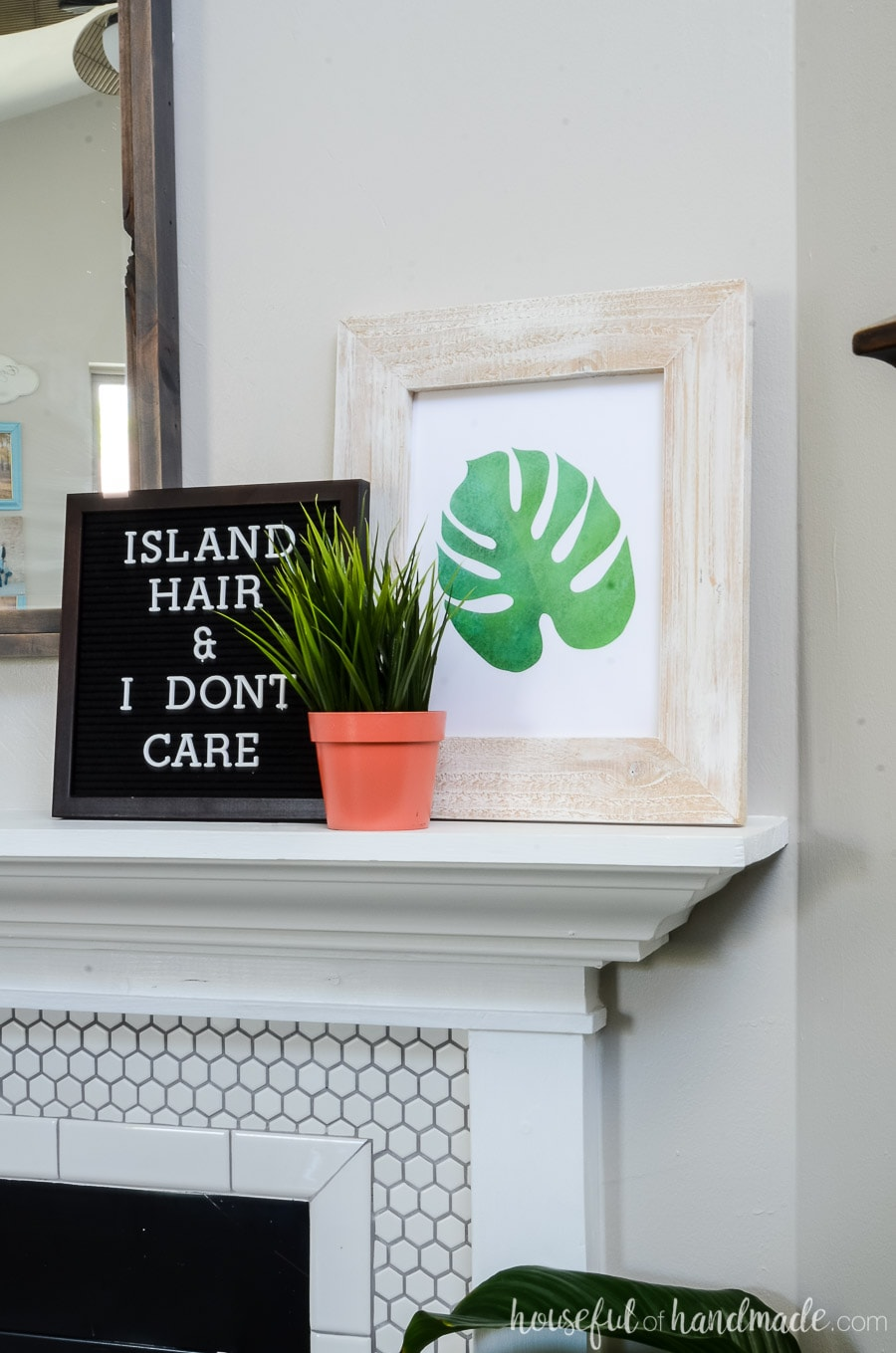 Tropical saying on the letter board and free printable tropical art are the perfect way to decorate from summer on a budget. See the entire tropical living room tour at Housefulofhandmade.com.