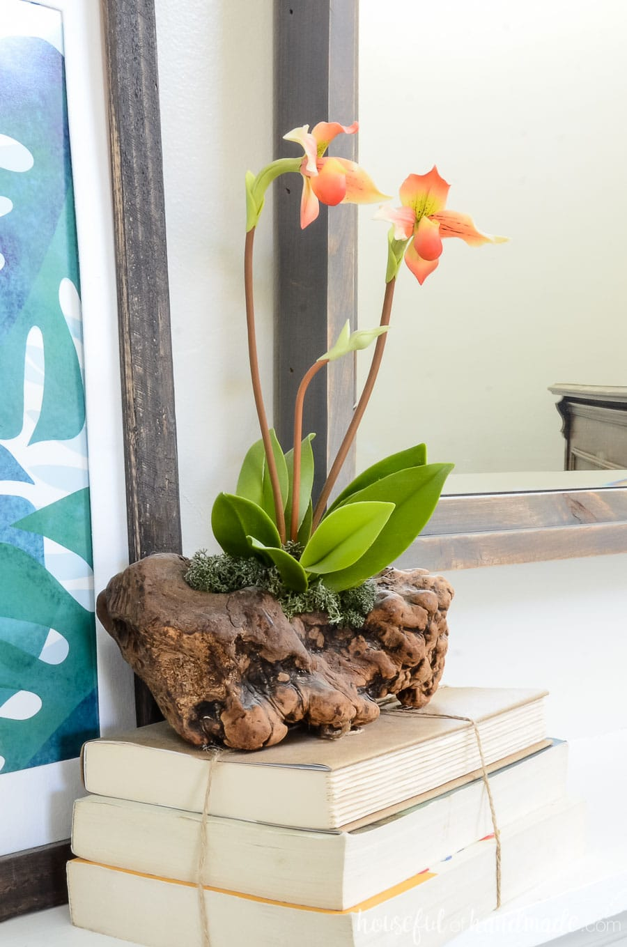 Beautiful orchid art is the starting point for our summer tropical living room. Housefulofhandmade.com