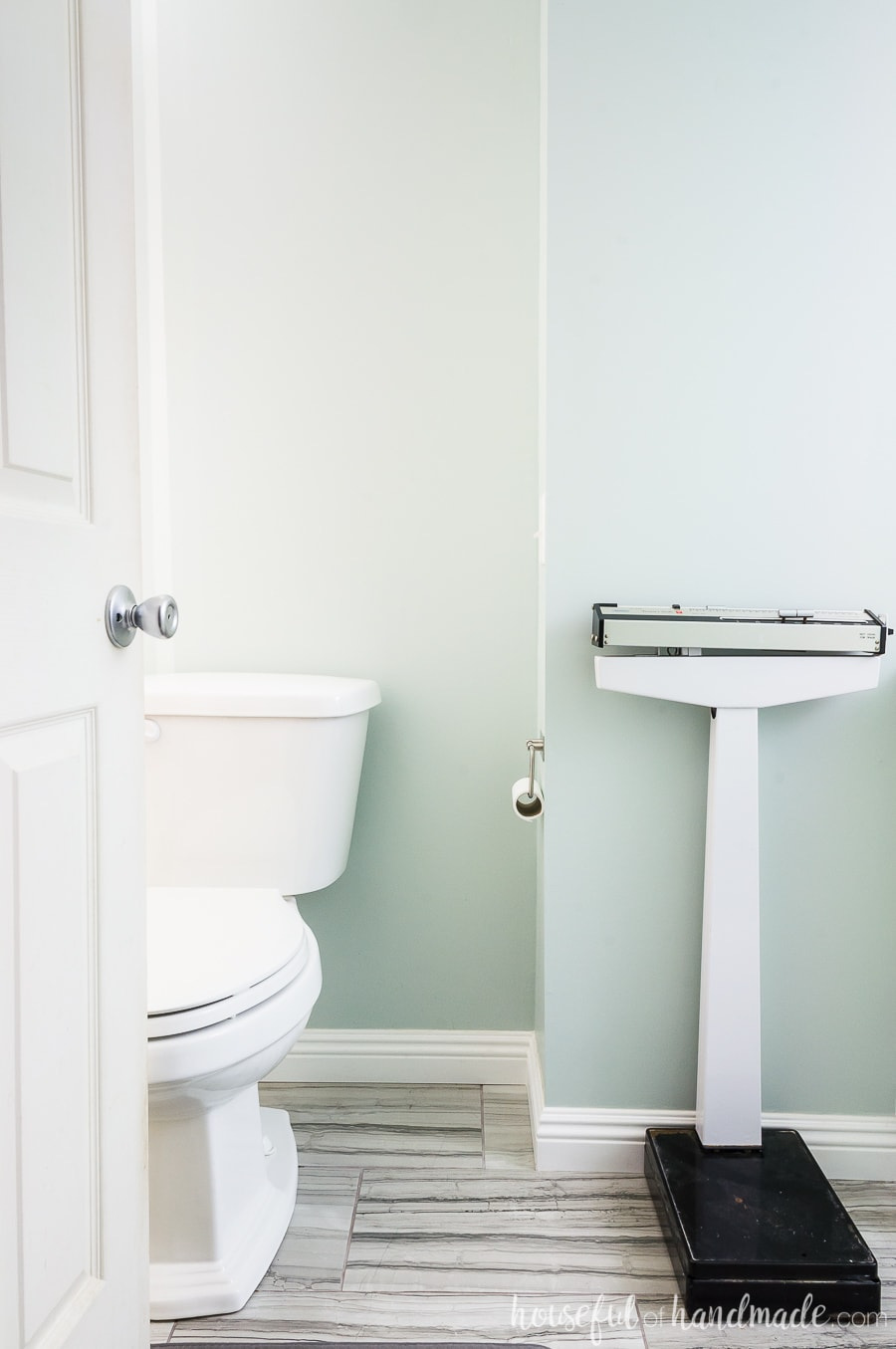Add charm to the master bathroom retreat with an old doctors scale.