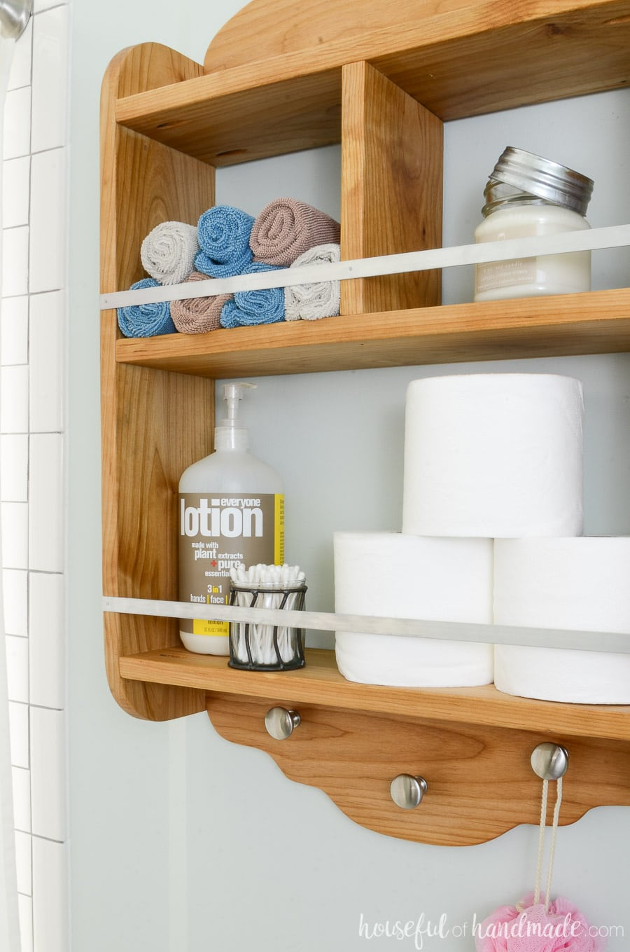 Farmhouse storage shelf in the bathroom is perfect for adding storage to a small bathroom.