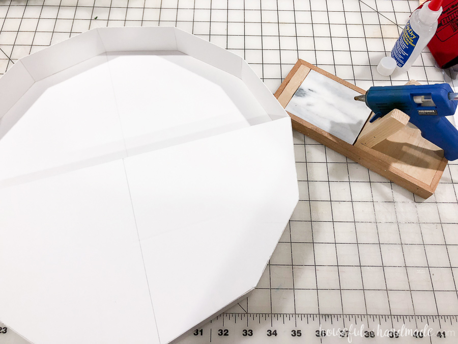 Step 6: Use hot glue to secure the front piece of foam board.