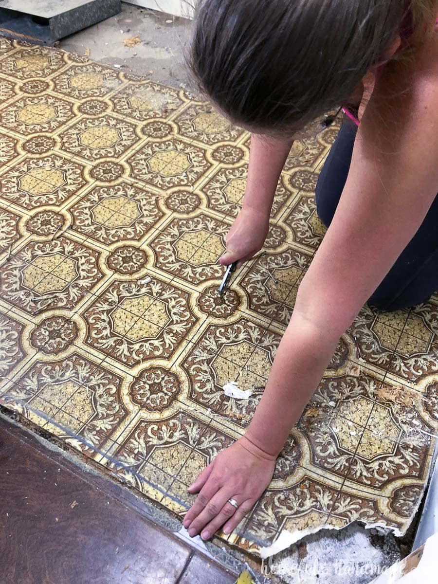Cut the old linoleum with a utility knife into strips to make it easier to remove.