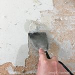 Easily remove old linoleum with a heat gun and putty knife to get your floor ready for new flooring.