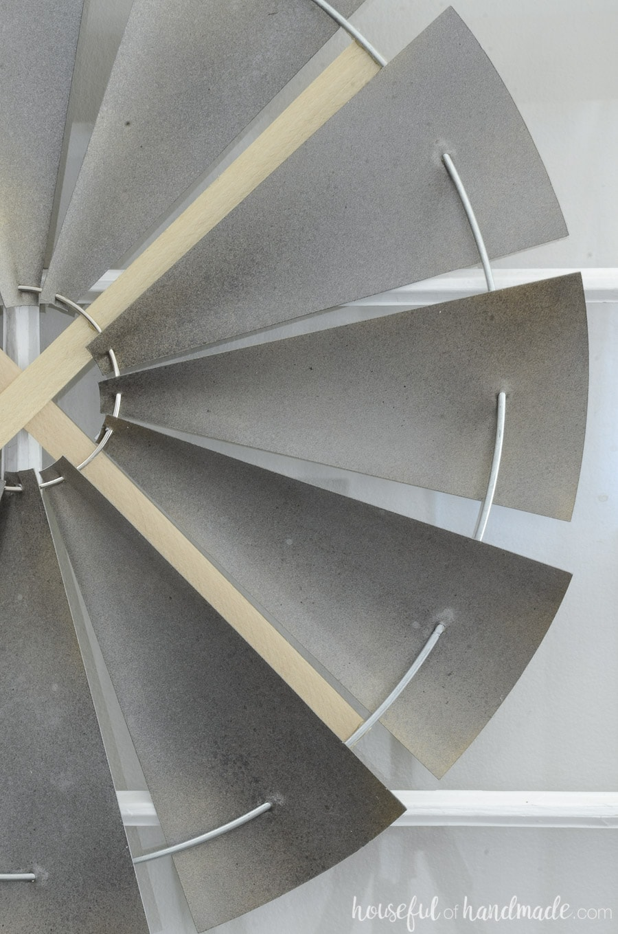 Close up of the faux metal blades of the decorative windmill.