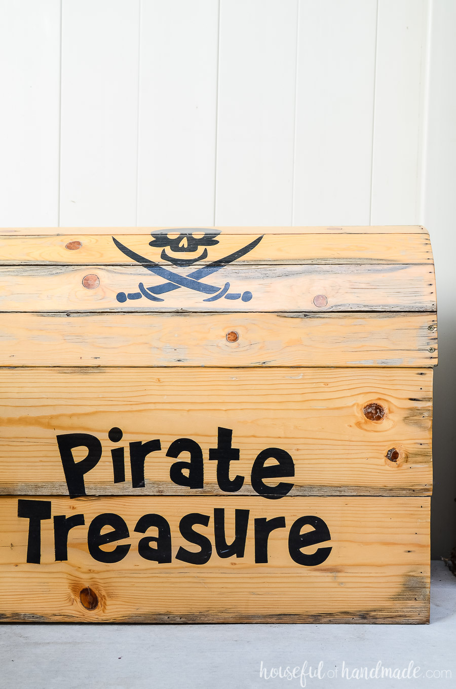 Homemade pirate treasure chest is the perfect outdoor toy box for the kids outdoor living spaces.