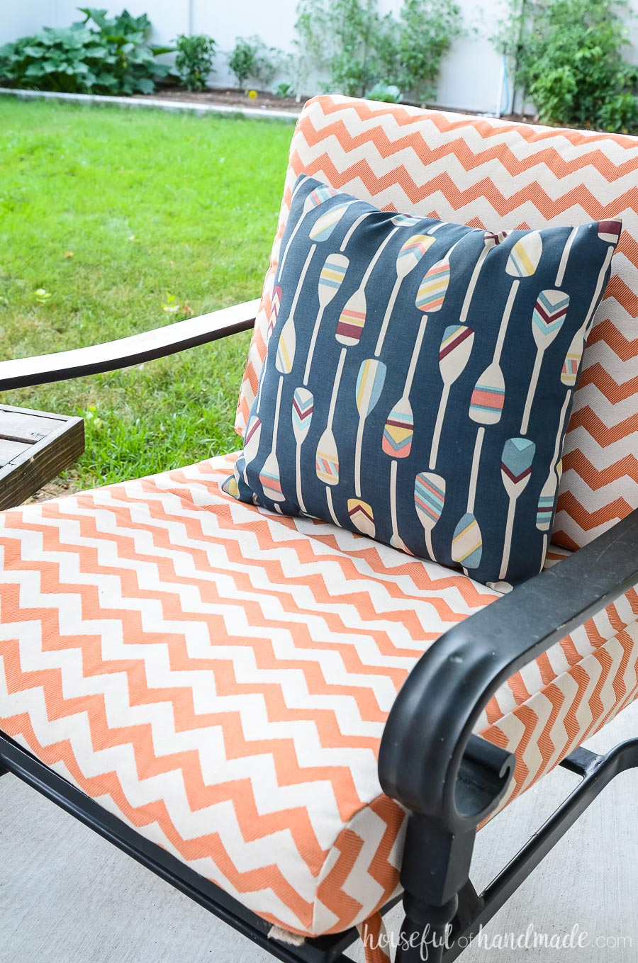 Bright colors give our outdoor living spaces an island vibe. These white and orange striped outdoor cushions are perfect with the colorful ores on a navy background pillow.