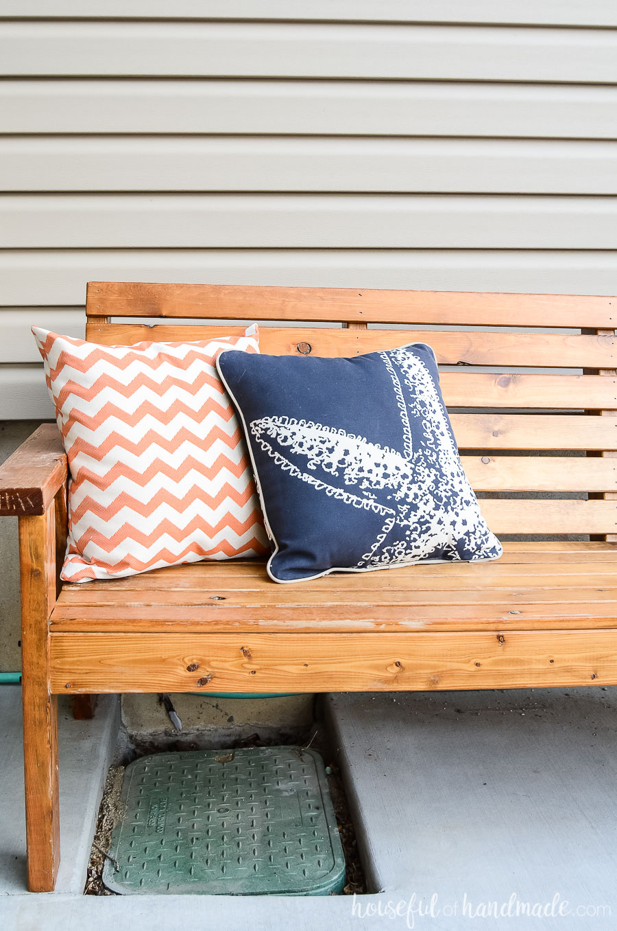 Outdoor bench with island inspired pillows gives our outdoor living space a tropical feel.