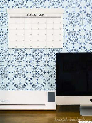 Printable large desk calendar on the wall in the desk nook with patterned wall and computer. Housefulofhandmade.com