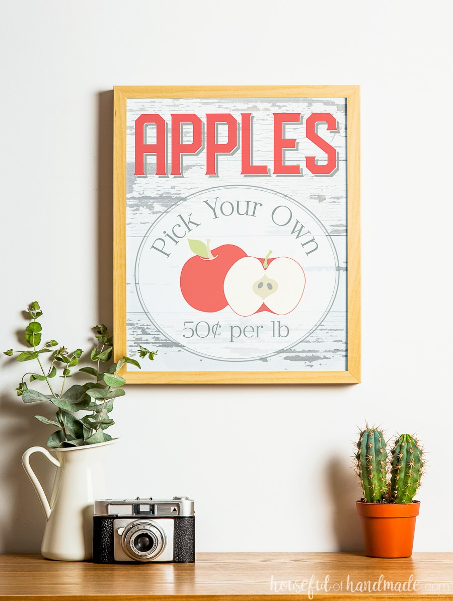 Rustic fall printable: Apples Pick Your Own sign. In a frame above fall decor.