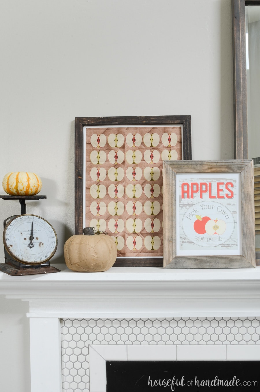 Two apple printables for fall in easy reclaimed wood picture frames next to a vintage scale. Perfect fall mantel decor.