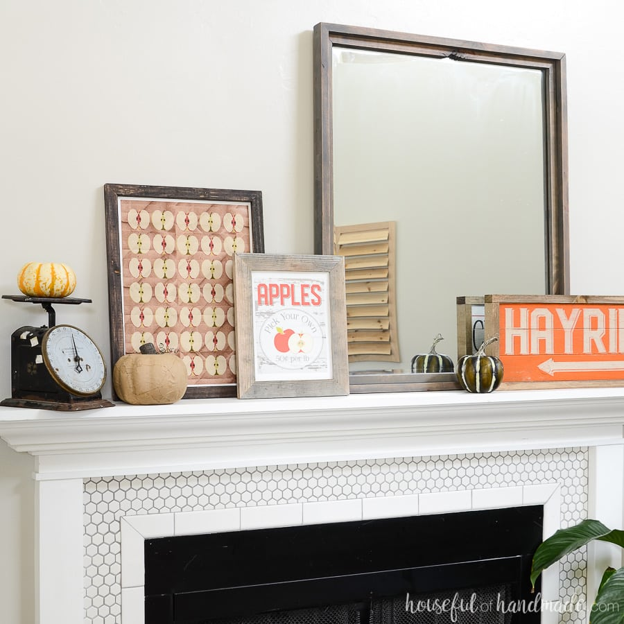 Fall mantel decorated with farmhouse wood signs and printables for fall. All the classic fall traditions are represented.