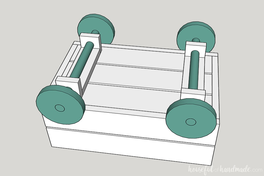 Step 4 to build a decorative wood wagon: add the wheels to the housing.