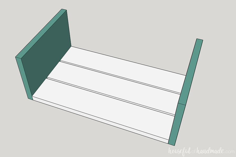 Step 1 to build a decorative wood wagon: Attach the front/back boards to the bottom slats.