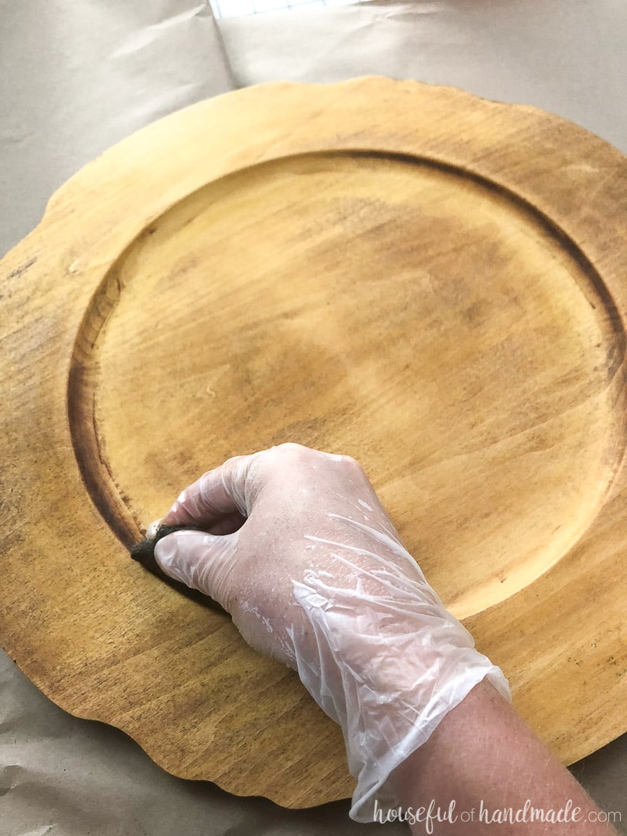 For the upcycled wood tray, use steel wool to scrape off the finish with the paint stripper in the hard to reach places.