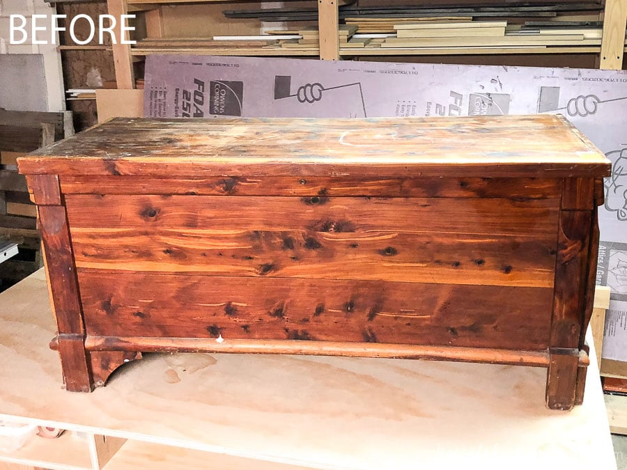 The before of our outdated cedar storage chest before we upcycled it into a coffee table.