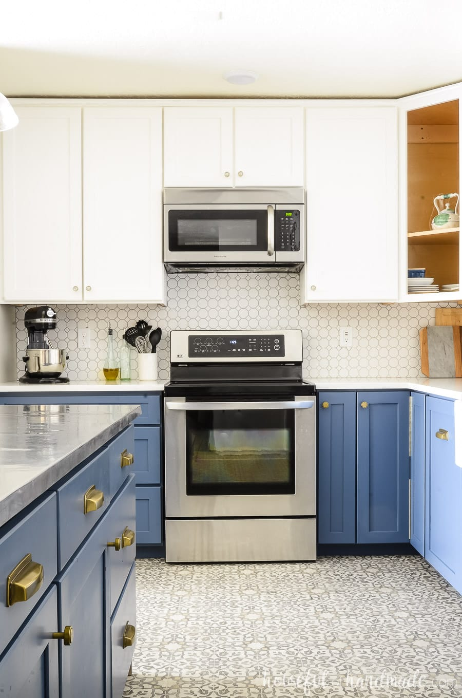 Kitchen remodel showing DIY routed cabinet doors. Blue lower cabinets and white upper cabinets.