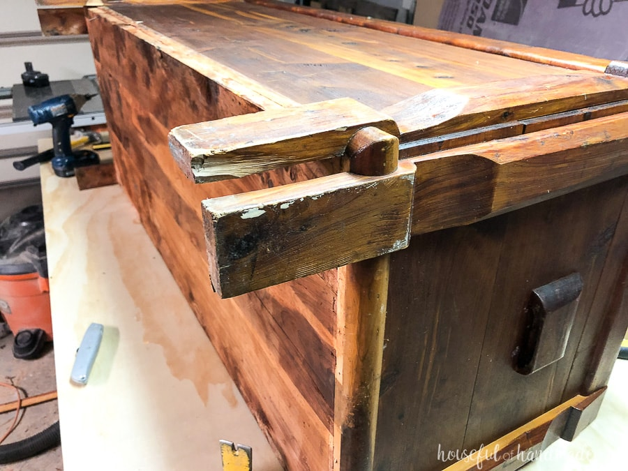 Close up of the damaged base and legs of the cedar chest.