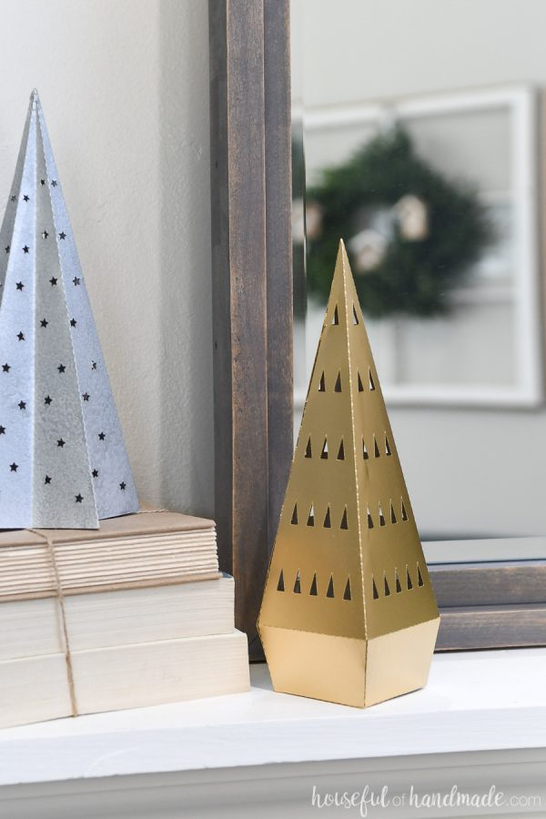 Gold modern Christmas tree made out of paper on a mantel.