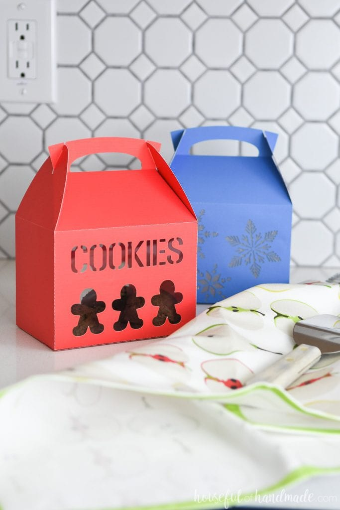 Red gingerbread cookie gift box and blue snowflake cookie box for packaging cookies for Christmas.
