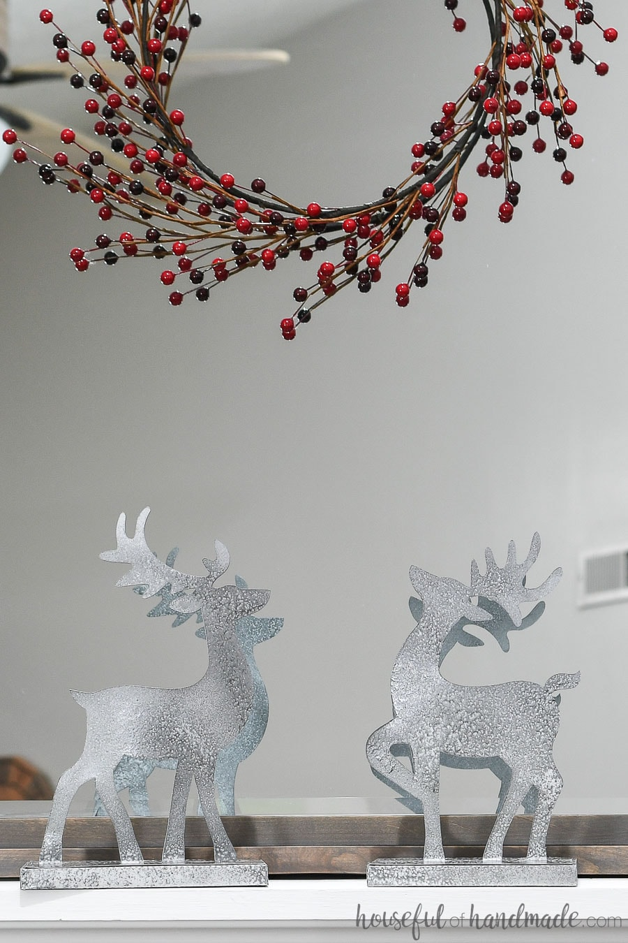 Christmas reindeer figurines made from paper and painted to look like metal.