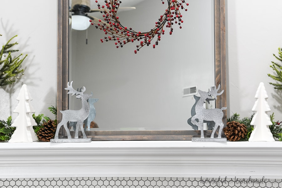Christmas mantel decorated with DIY reindeer figurines.