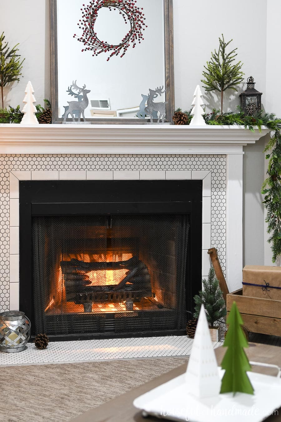 Fireplace and mantel all decorated with Classic Christmas decor.