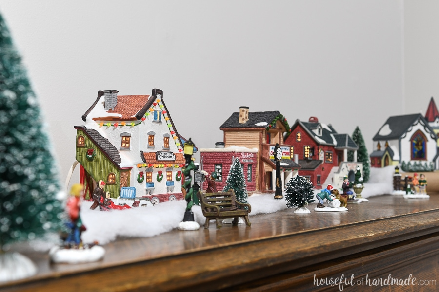 Classic Christmas village on top of the piano as part of the Classic Christmas home tour.