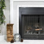 Closeup view of the fireplace hearth decorated for the classic Christmas mantel.