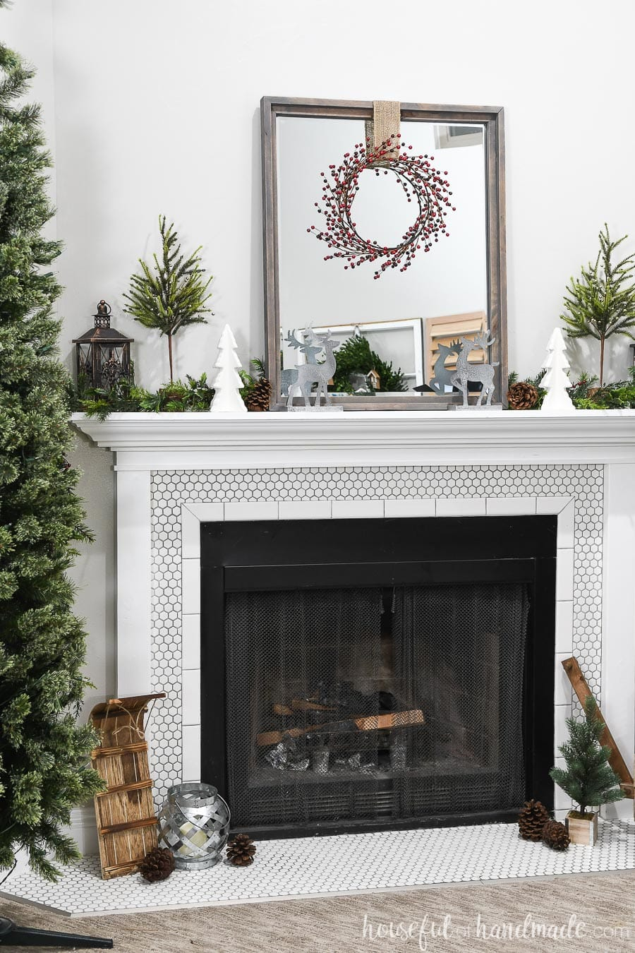 Beautiful white fireplace decorated for Christmas with classic details.