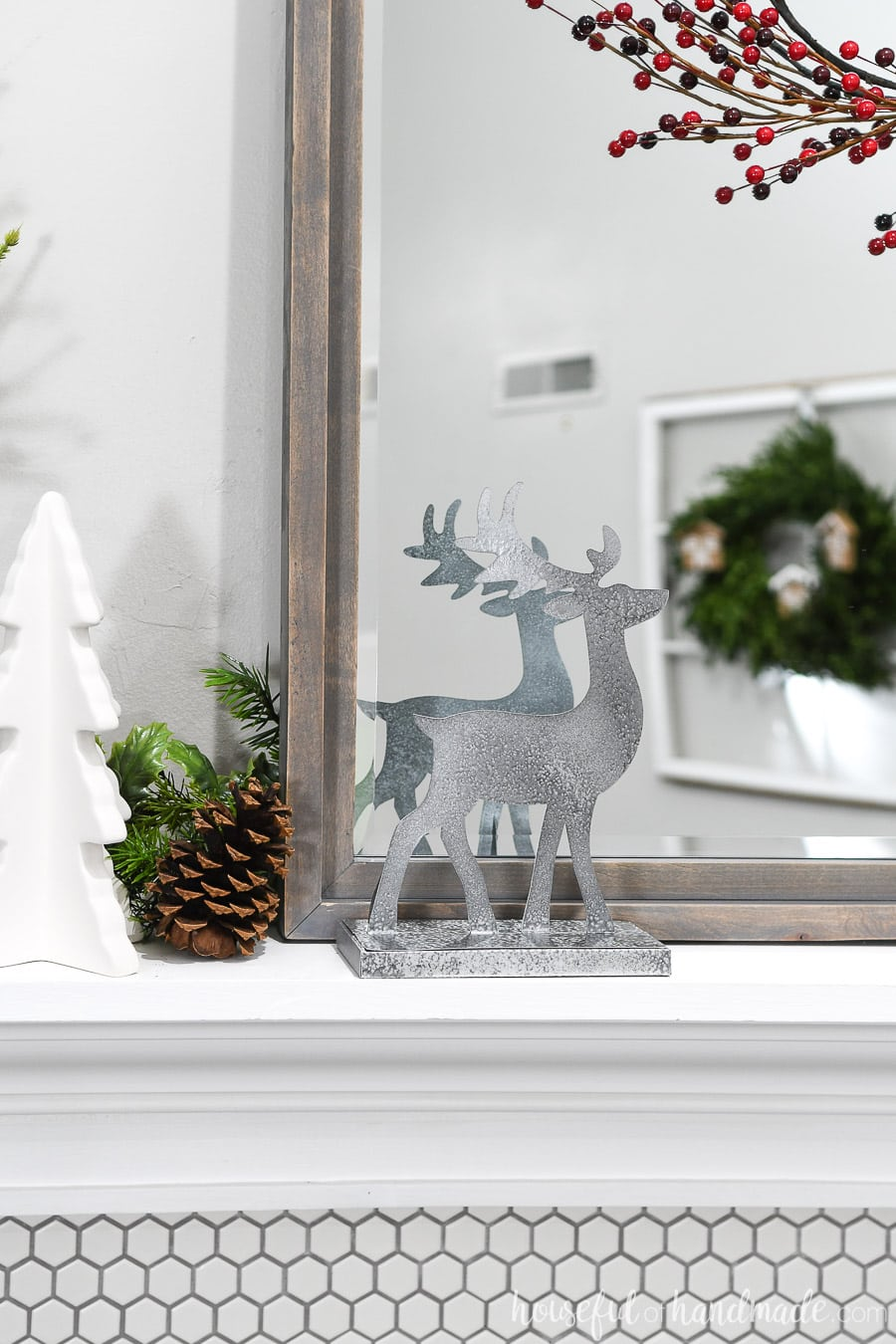 Reindeer figurines on the mantel as part of the classic Christmas decor.