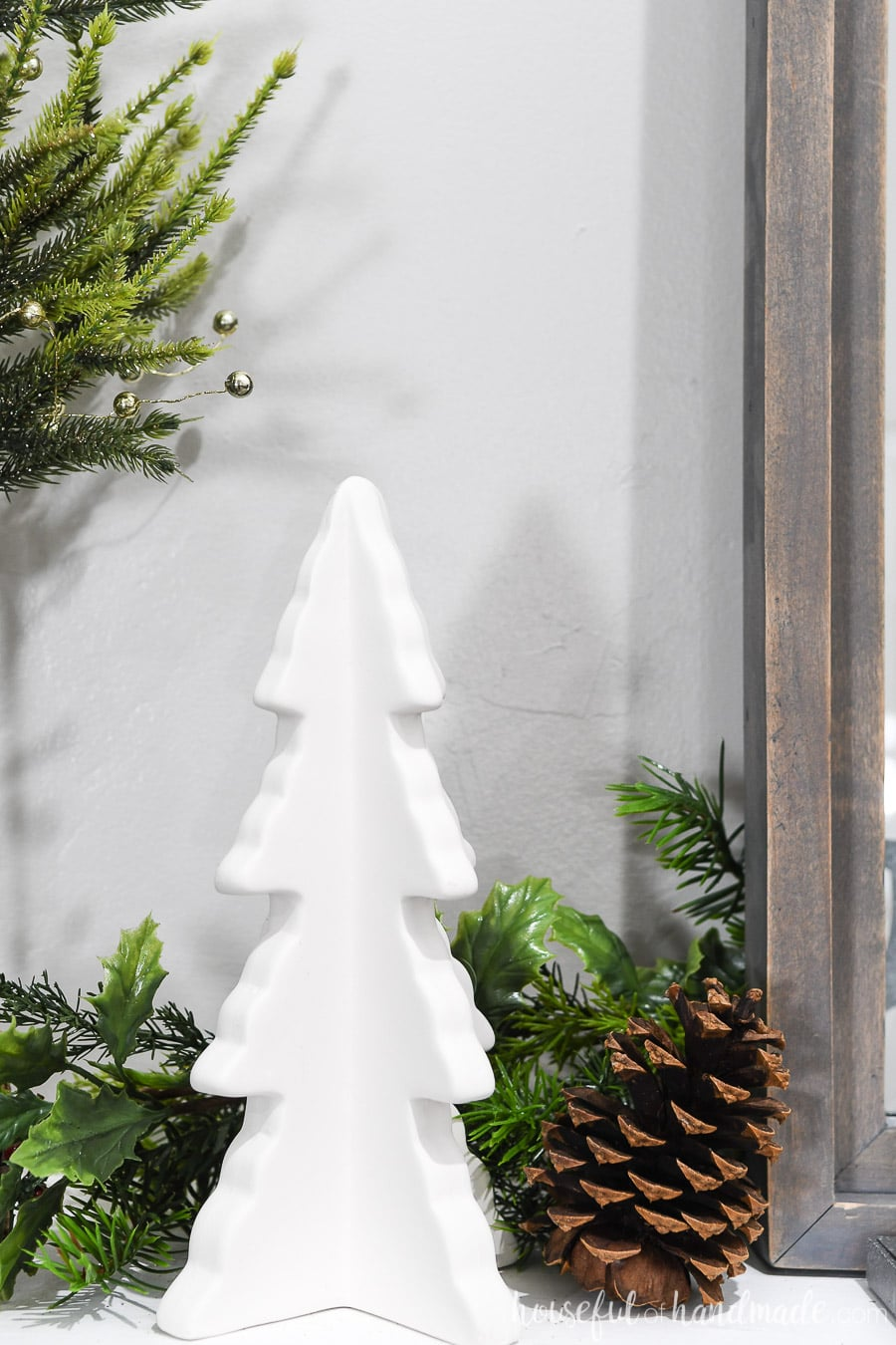 Close up of the ceramic Christmas tree on the classic Christmas mantel.