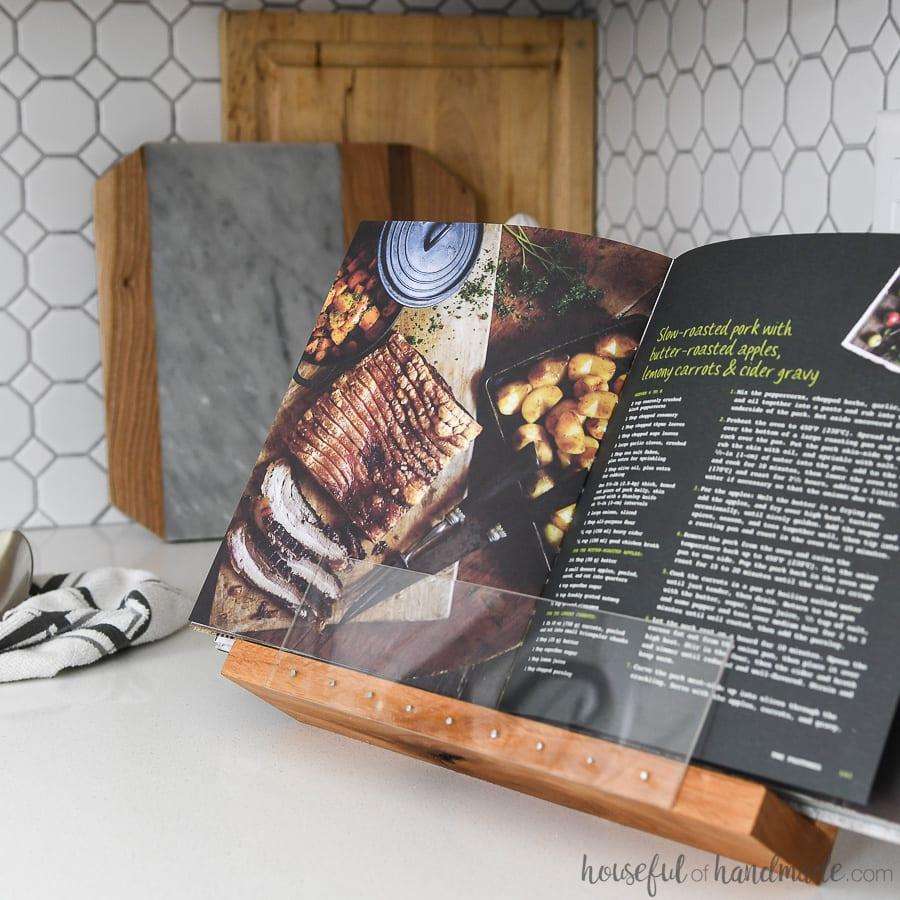 Cookbook being held open for hands-free cooking in a DIY cookbook holder.