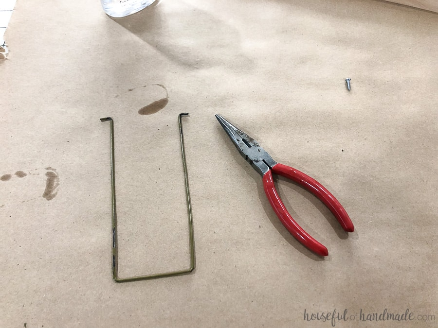 Step 6: create a wire kick-stand out of a wire hanger.