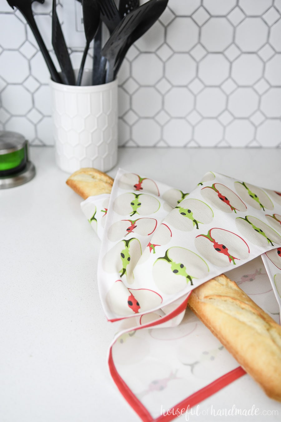 Baguette wrapped in a whimsical apple printed tea towel.
